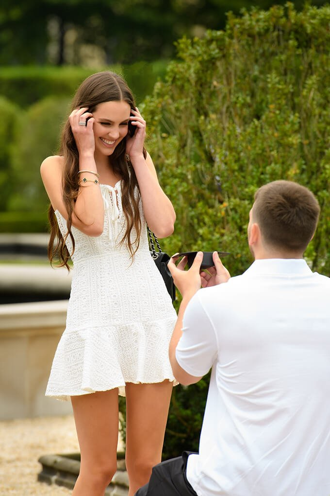 Surprise proposal smile showing her the ring