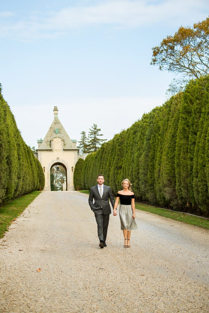 Engaged couple walking at Oheka Castle's driveway