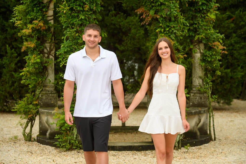 Engaged couple by the gazebo at Oheka Castle
