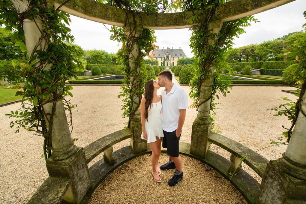 Engaged couple inside the gazebo at Oheka Castle