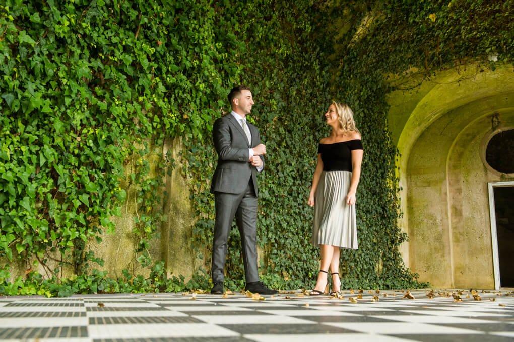 Engaged couple inside of Oheka Castle's pool