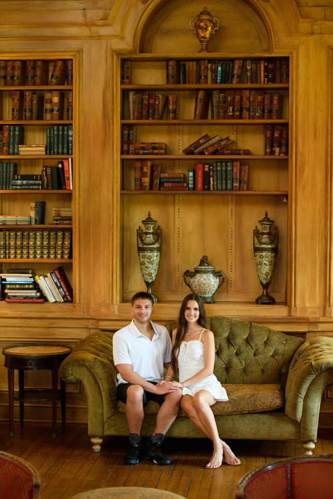 Couple sitting on the couch in Oheka Castle's library