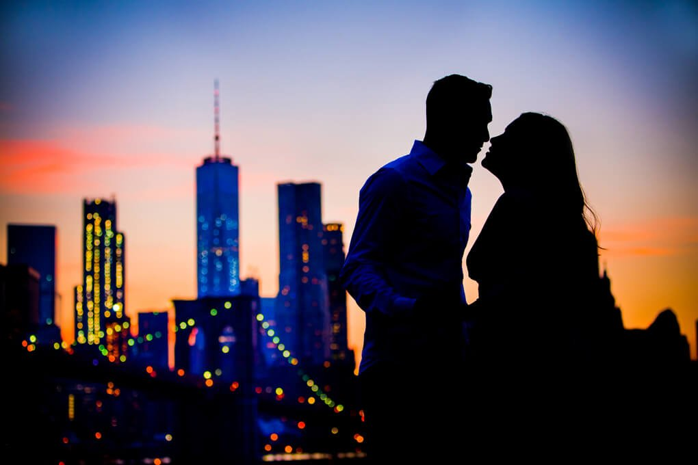 Engaged couple silhouette in Dumbo