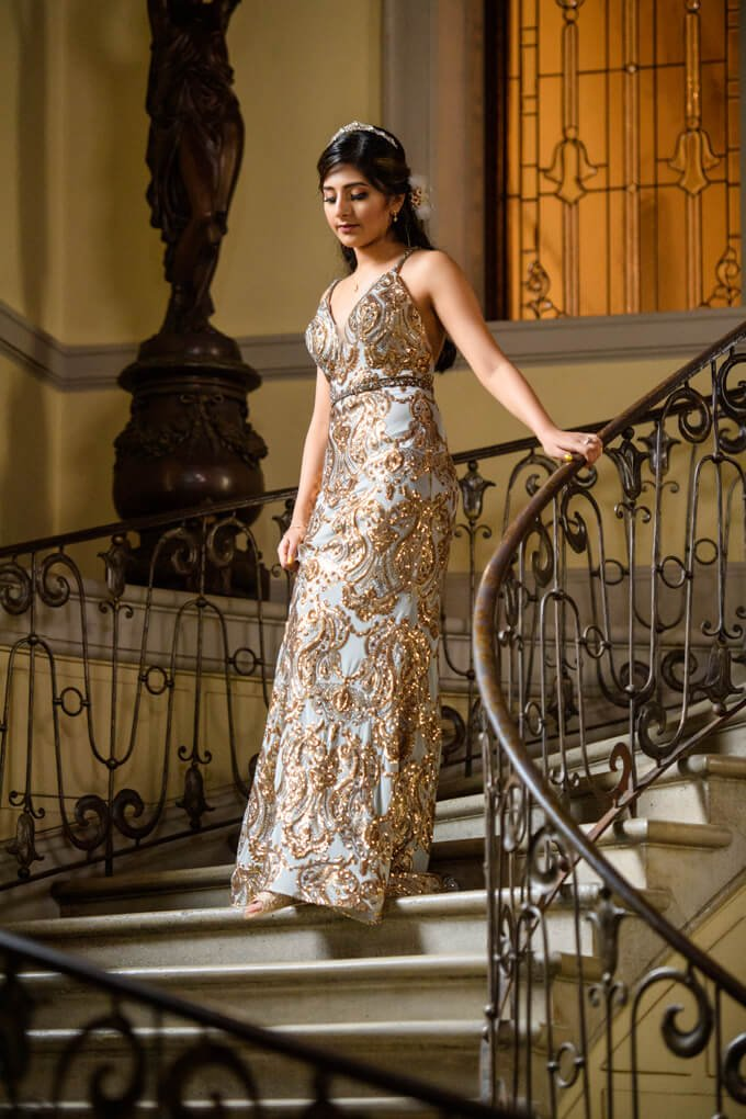 Sweet 16 birthday girl on Oheka Castle stairs