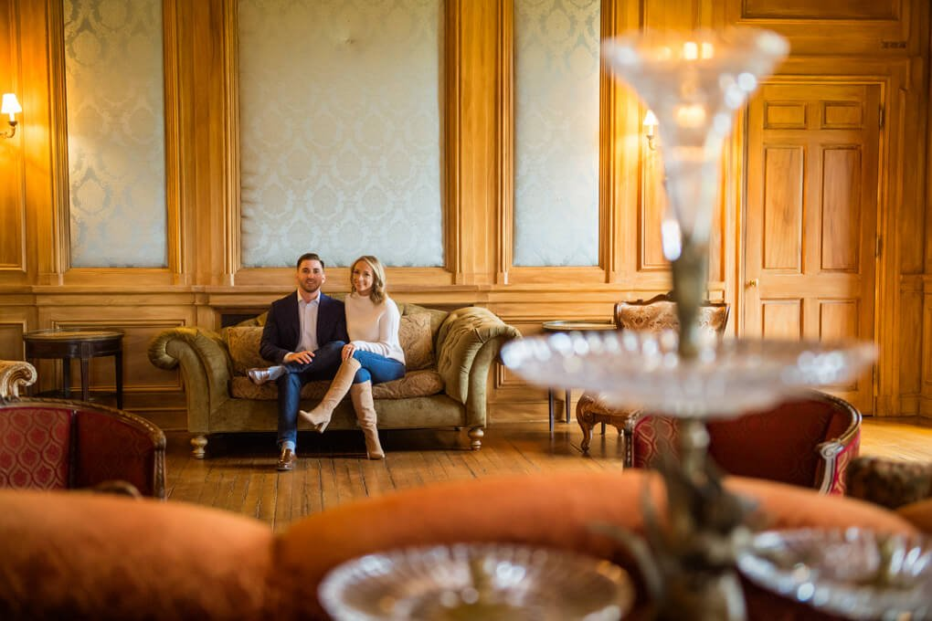 Engaged couple in Oheka Castle Library
