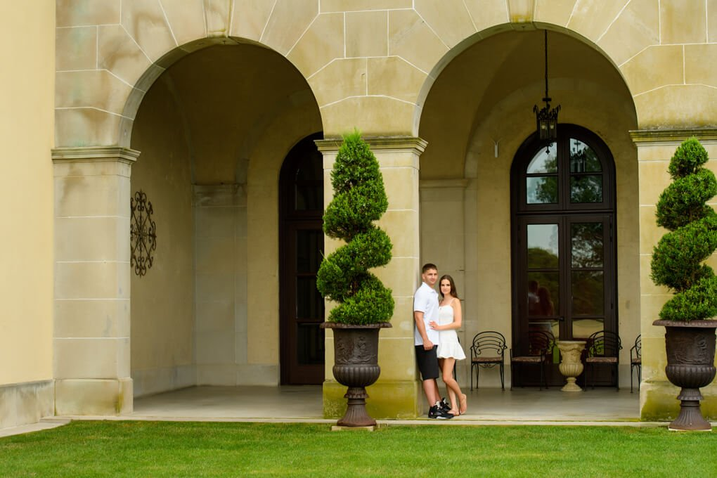A couple in front of Arches at Oheka