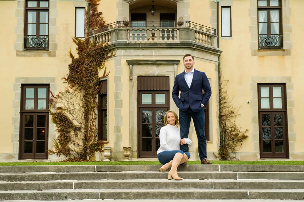 Engaged couple with Oheka Castle background