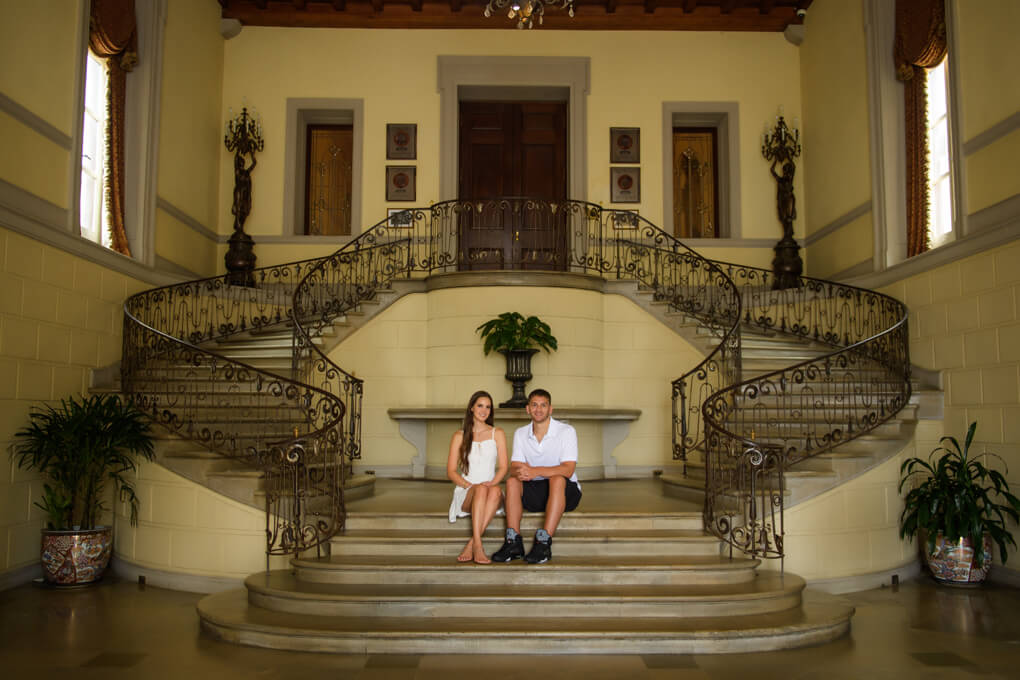 Couple sitting at Oheka Castle's stairs