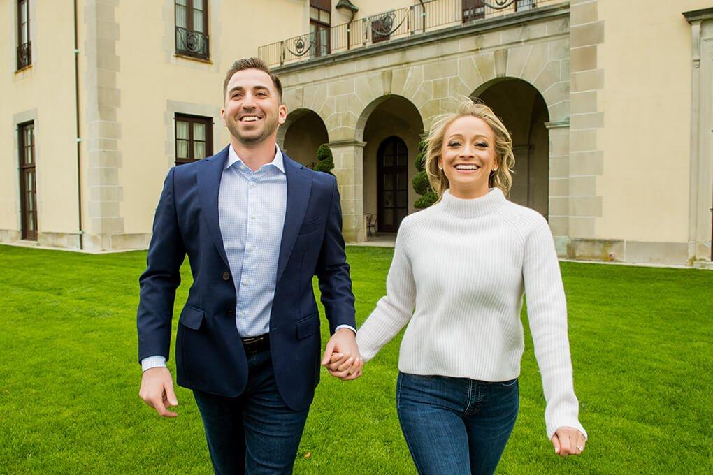 Engaged couple running at Oheka Castle