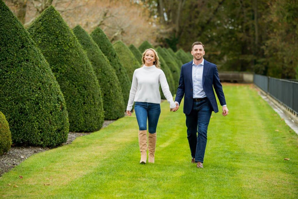 Engaged couple walking at Oheka Castle
