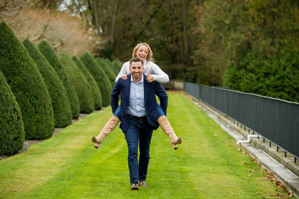 Engaged couple having fun at Oheka Castle