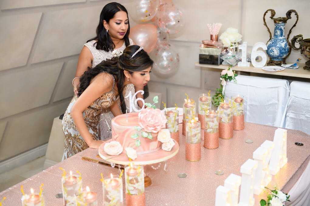 Oheka Castle sweet 16 cake blowing out