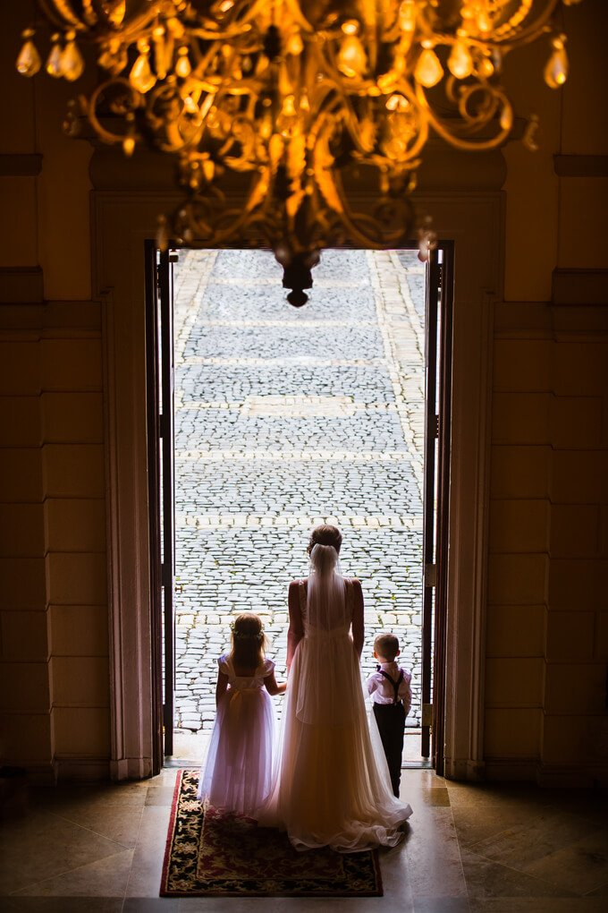 Oheka Castle front door bride with the ring bearer and flower girl