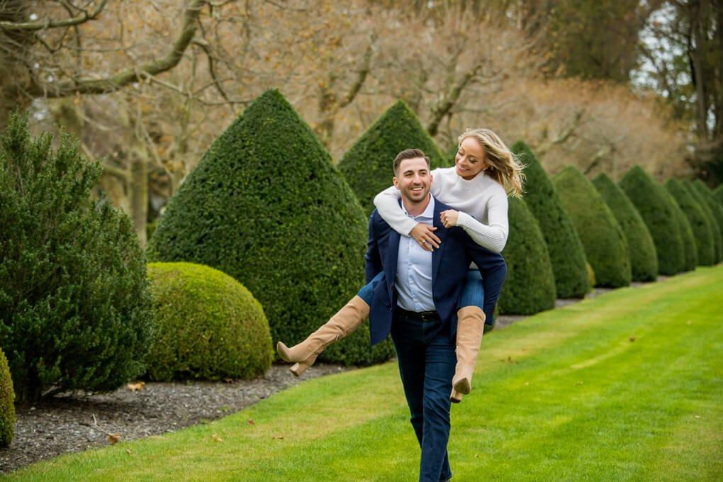 Engaged couple having fun at Oheka