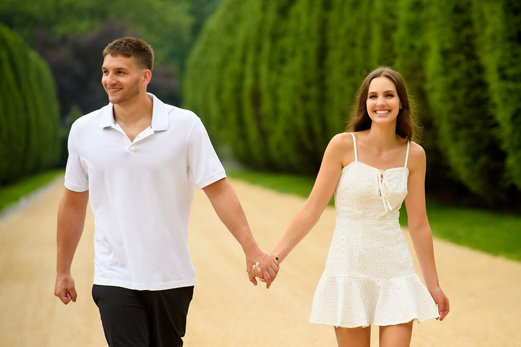 Couple smiling holding hands