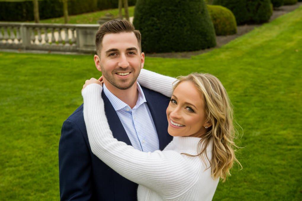 Engaged couple playing at Oheka Castle