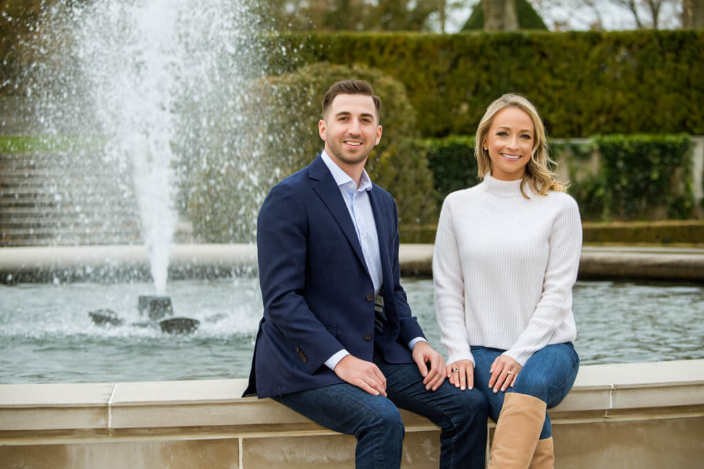 Engaged couple and fountain at Oheka Castle