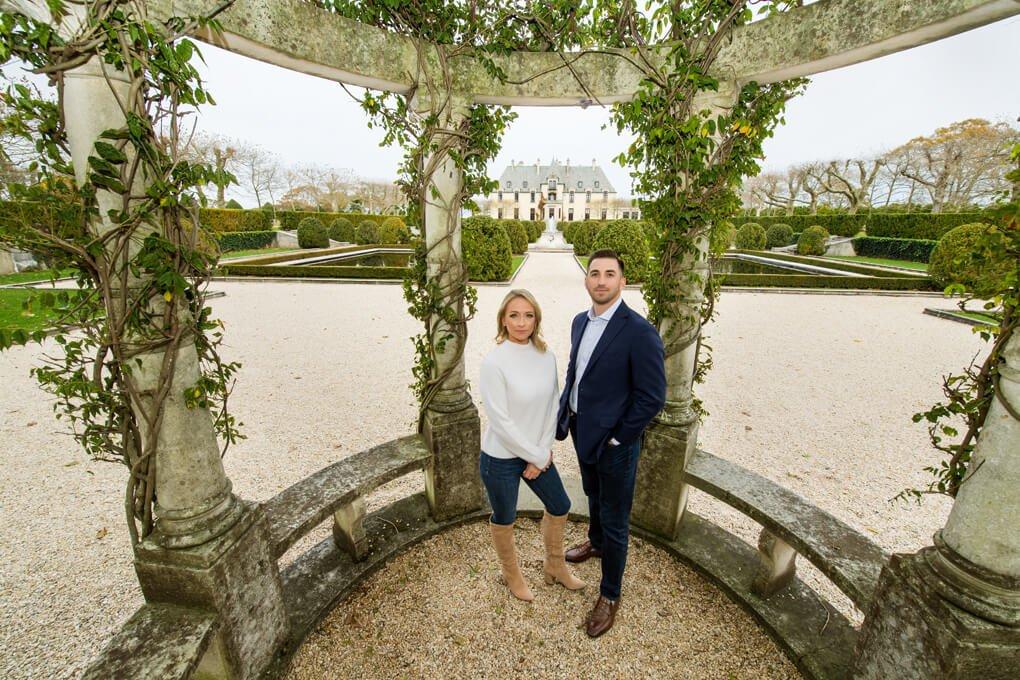 Engaged couple inside gazebo at Oheka castle