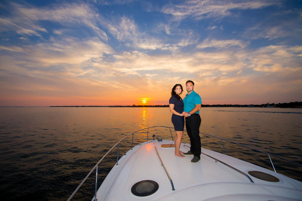 Engaged couple on boat sunset photo